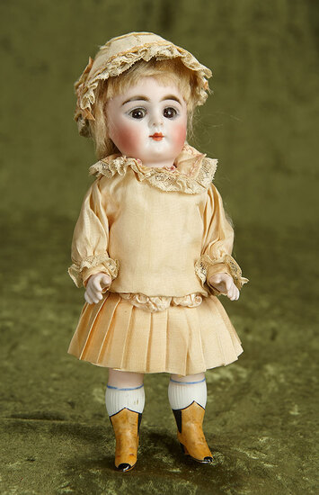 """9"""" Large German all-bisque doll, model 184, by Kestner with painted yellow boots. $500/700"""
