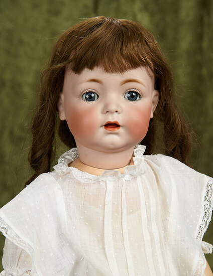 "19"" German bisque toddler, model 121, by Kammer and Reinhardt, antique costume. $500/700"