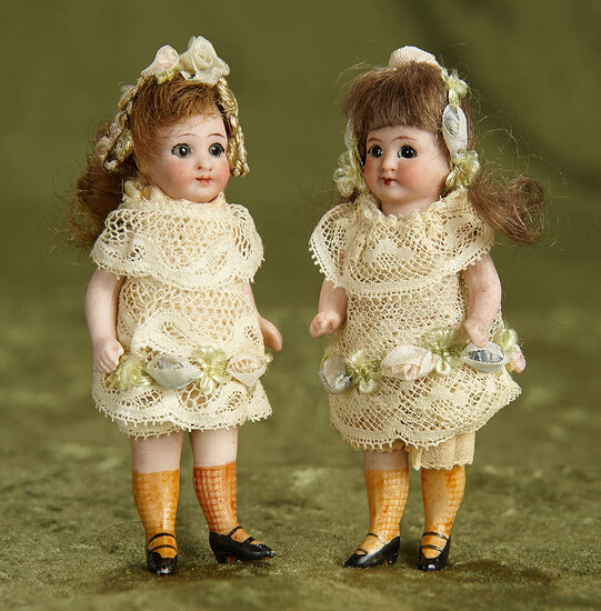 """3 1/2"""" Pair, German all-bisque dolls with glass eyes, rare yellow painted stockings. $300/500"""