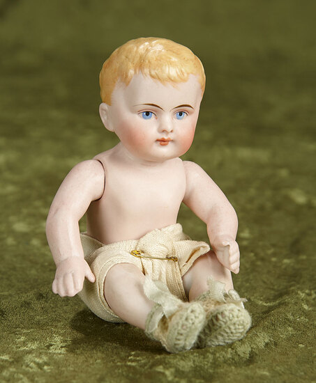 """7"""" German all-bisque character with blonde painted hair, jointed limbs. $300/500"""