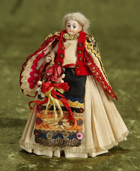 """5"""" German bisque miniature doll with rare elaborate folklore costume. $200/300"""