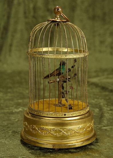 Swiss Mechanical Singing Bird in Gilded Cage by Reuge. $800/1100