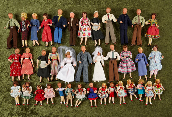 Thirty German dollhouse dolls by Caco including men, women, children, original costumes.  $200/400