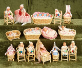 Sixteen German dollhouse babies in original presentation with accessories by Caco $300/400