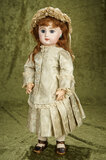 French bisque bebe by Emile Jumeau, size 8, with original signed body $3000/3500