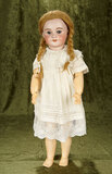 French bisque bebe with keywind mechanical walking body, original wig and dress $600/800