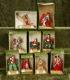 Nine miniature Japanese dolls in theatrical or ceremonial costumes, original boxes $200/400