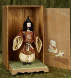 Japanese portrait figure of young man with elaborate costume and cap, original base and box $300/500