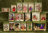 Seventeen Japanese miniature dolls in theatrical poses in original boxes $300/500