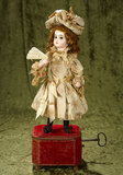 French musical automaton featuring Bebe Jumeau with fan by Roullet et Decamps $2000/2500