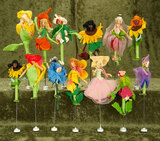 Thirteen German cloth miniature puppets with rare floral designs, in early BAPS box $300/500