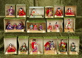 Sixteen boxes of miniature Japanese dolls in theatrical pose, original stands and boxes $300/400