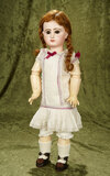 French bisque bebe by Emile Jumeau in original early Jumeau chemise $2800/3400