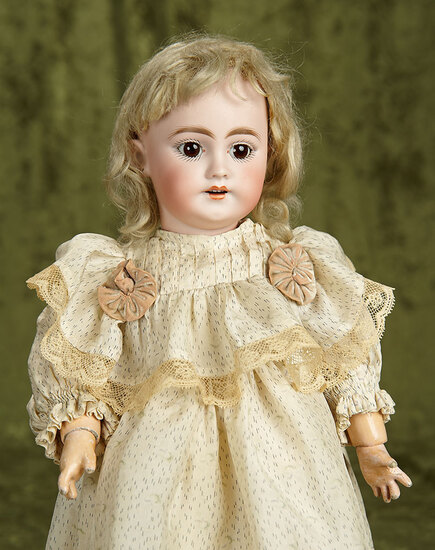 """16"""" German bisque child, 1009, by Simon and Halbig with antique mohair wig. $400/500"""