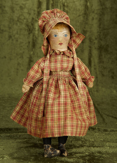 American cloth folk doll with oil-painted facial features and antique costume. $500/700