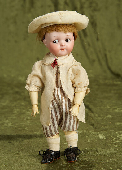 """11"""" German bisque googly, model 200, by Marseille in delightful costume. $400/600"""