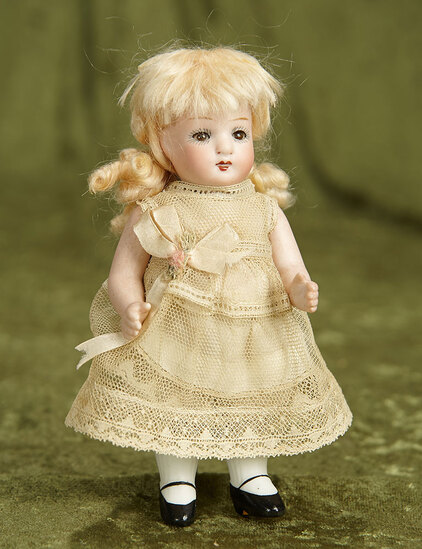 """5 1/2"""" German all-bisque miniature doll with glass sleep eyes. $200/300"""