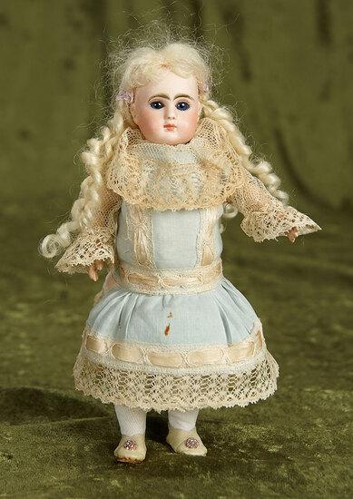 "8"" Tiny French bisque bebe, La Parisien, Size 0, by Jules Steiner. $1100/1400"
