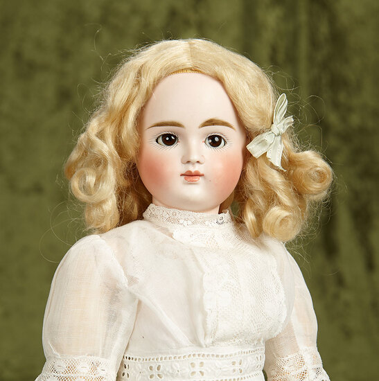 """17"""" German bisque closed mouth doll, VII, by Kestner with original wig. $1200/1600"""