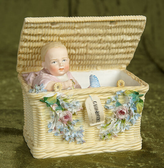 """7""""l. German bisque candy container """"Cabin-Baggage"""" by Gebruder Heubach. $600/900"""