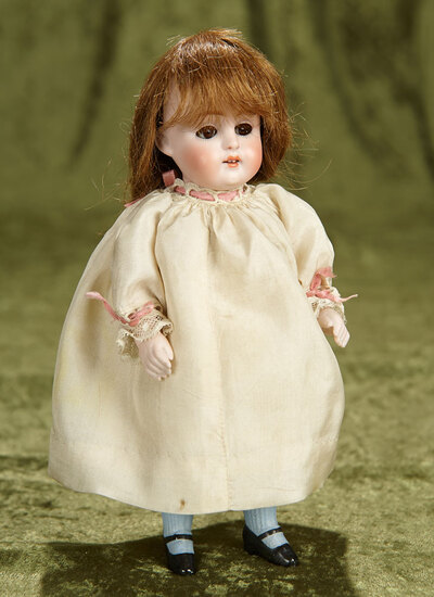"""8"""" Large German all-bisque blue-stocking miniature doll, 150, by Kestner. $400/500"""