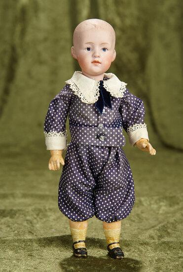 "10"" German bisque pouty child, 7035, by Gebruder Heubach. $300/400"
