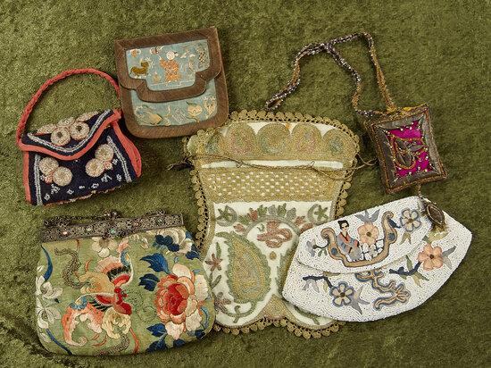Lot of early needlework purses. $400/500