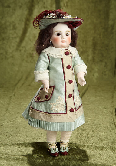 "15"" Sonneberg bisque closed mouth doll in beautiful costume. $800/1200"