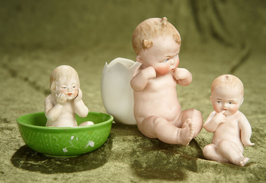 "3""-5"". Trio of German all-bisque character children, amusing poses by Gebruder Heubach. $400/600"