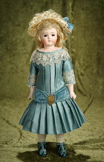 "18"" German bisque closed mouth doll by Kestner with beautiful silk costume. $800/1000"