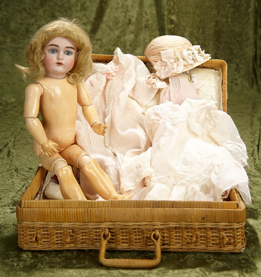 "16"" German bisque child, 167, by Kestner in wicker basket with costumes. $800/1000"