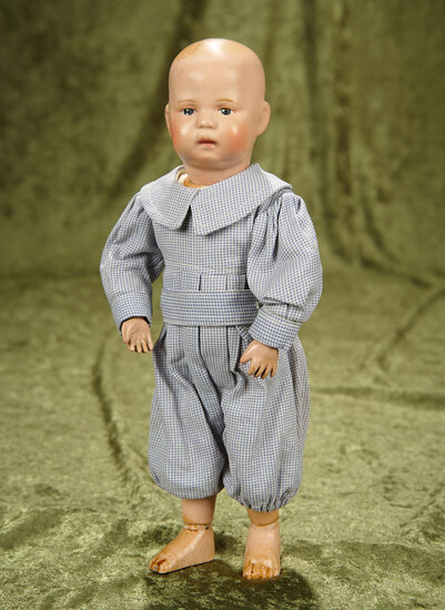 "11"" American wooden pouty-faced toddler by Schoenhut with painted hair. $400/500"