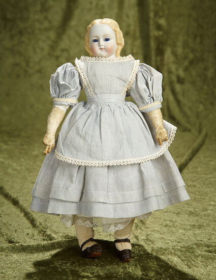 "12"" German bisque doll with blonde sculpted hair and blue glass eyes. $500/700"