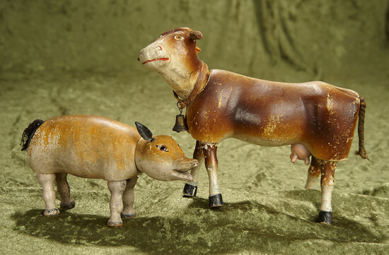"7"" and 8 1/2"" Carved wooden cow and glass-eyed pig from Schoenhut farmyard set. $400/600"