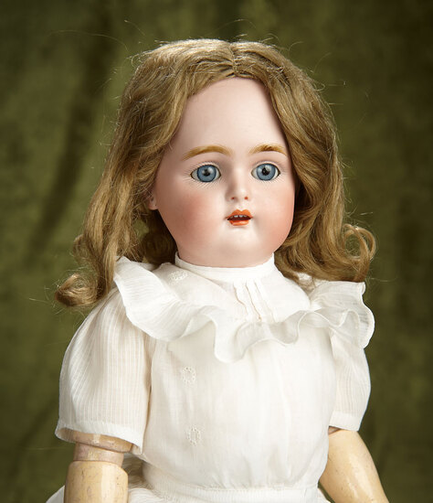 "16"" German bisque child by K*R with pretty dolly-face model. $400/500"