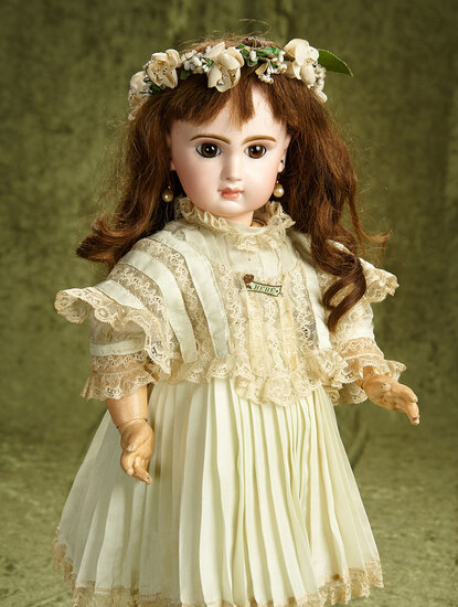 "20"" French bisque brown-eyed Bebe Jumeau in pretty silk dress. $2200/2800"