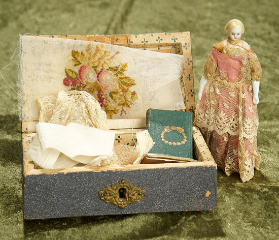 "5"" German bisque miniature doll in wooden box with memorabilia. $300/500"