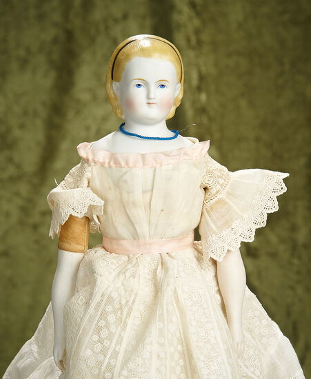 "17"" German bisque lady doll with sculpted blonde hair. $400/500"