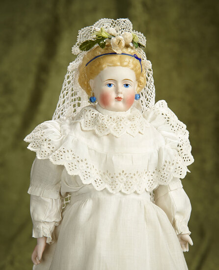 "14"" German Bisque Doll with Blonde Sculpted Hair and Blue Hair Ribbon. $400/500"