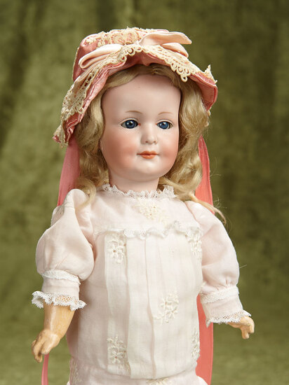 "15"" German bisque smiling child, model 550 by Marseille. $400/500"