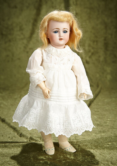 "12"" German bisque child, 1249 by Simon and Halbig. $400/500"