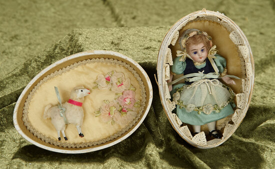 """4"""" German all-bisque miniature doll in presentation Easter Egg. $400/500"""