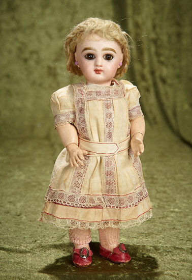 """11"""" French bisque brown-eyed bebe, size 2, in original chemise, by Emile Jumeau. $3800/4200"""