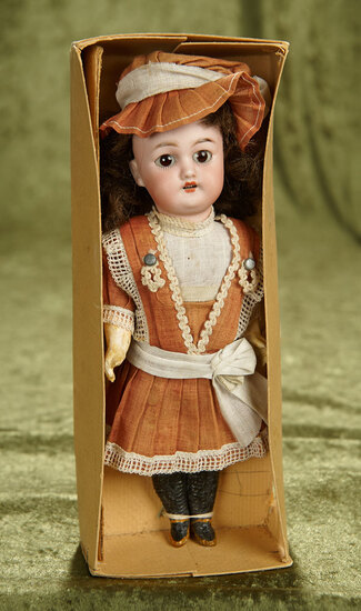 """9"""" German bisque child, 1079, by Simon and Halbig with original costume and box. $400/500"""