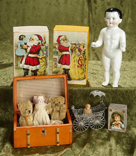 """7"""" German all-porcelain """"Frozen Charlotte"""", trunk of miniature dolls, bears and toys. $500/700"""