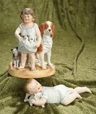 Two German all-bisque figurines of children with pets by Hertwig. $300/500