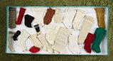 Twenty-two pairs of antique doll socks. $300/400