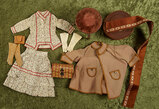 Various French poupee costume pieces, silk ribbon bolt, and early velvet-covered stool. $600/800