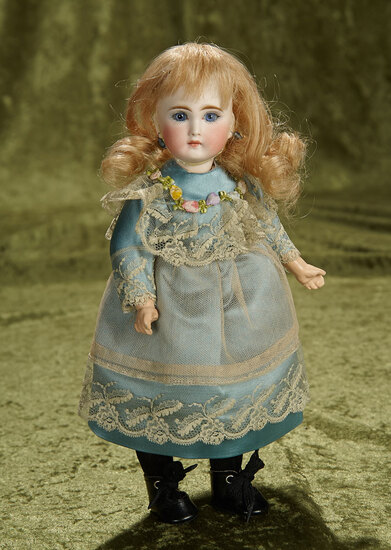 "11"" Sonneberg bisque child with closed mouth as French look-alike. $600/900"