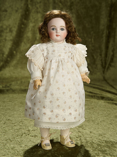 "14"" German bisque doll with closed mouth by Kestner, original body and body finish. $800/1000"